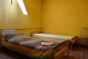 A bed or beds in a room at Hostelis Ķipītis
