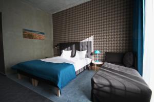 Voodi või voodid majutusasutuse Kurshi Hotel & Spa toas