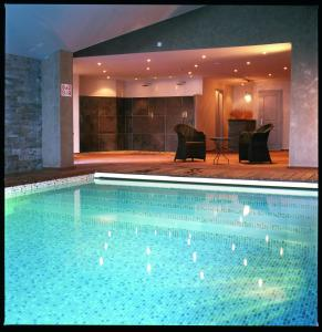 The swimming pool at or close to Hôtel Antares & Spa