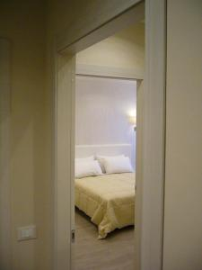 Ein Bett oder Betten in einem Zimmer der Unterkunft Grignetti Bed