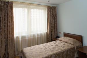 Кровать или кровати в номере Гостиница РАНХиГС