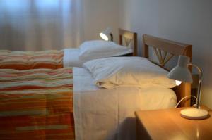 Cama ou camas em um quarto em Alloggi Barbaria