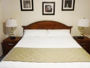 A bed or beds in a room at University Motel Suites