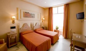 A bed or beds in a room at Los Helechos