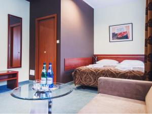 A bed or beds in a room at Hotel Chmielna Warsaw