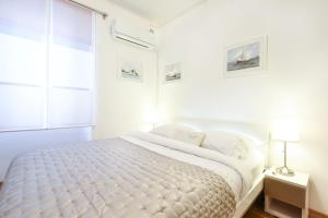 A bed or beds in a room at Central Palace Apartment