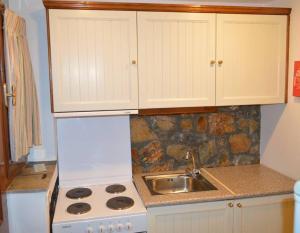 Η κουζίνα ή μικρή κουζίνα στο Elia Village