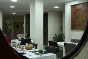 A restaurant or other place to eat at Hotel Bel Horizon