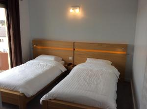 A bed or beds in a room at Hotel Bel Horizon