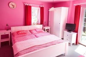 A bed or beds in a room at Slunecni Dum