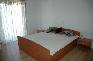 A bed or beds in a room at Babo Apartments