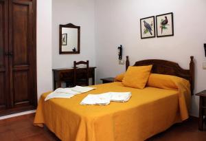 Cama o camas de una habitación en Apartamentos Casa Gil