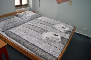 A bed or beds in a room at Penzion Po Vode