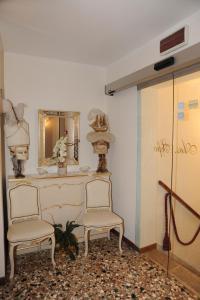 Uma área de estar em Alloggi Santa Sofia