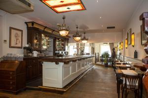 Restaurant ou autre lieu de restauration dans l'établissement Prins Appartementen