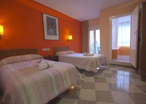 Cama o camas de una habitación en Pension Alcazaba