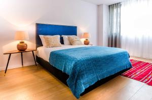 A bed or beds in a room at Lisbon Serviced Apartments - Liberdade