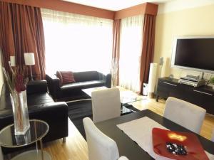 Een zitgedeelte bij River Diamond Luxury Apartments