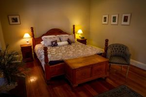 A bed or beds in a room at Tizzana Winery Bed and Breakfast