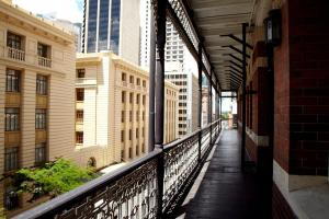 A balcony or terrace at Nomads Brisbane Hostel