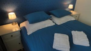 A bed or beds in a room at Bickersbed