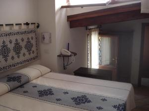 A bed or beds in a room at Guest House Il Giardino Segreto