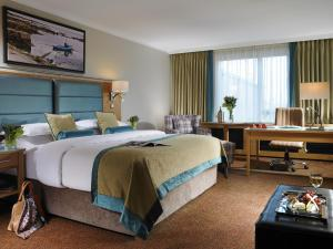 A bed or beds in a room at Radisson BLU Hotel and Spa, Limerick