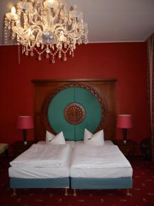 Кровать или кровати в номере Altstadthotel Am Theater