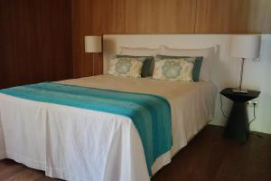 A bed or beds in a room at As Cabanas dos Netinhos