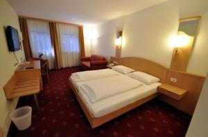 Letto o letti in una camera di Cityhotel Tallero
