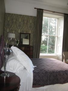 A bed or beds in a room at Flemings Country House