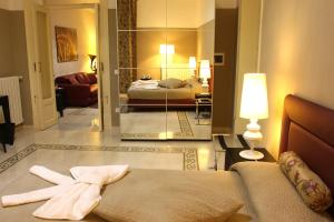 A bed or beds in a room at Abatellis Luxury