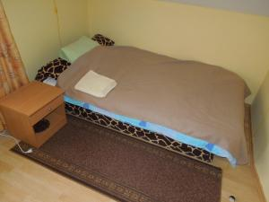 A bed or beds in a room at Robežu iela 1