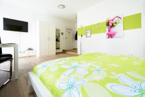Ein Bett oder Betten in einem Zimmer der Unterkunft Breisach City-Appartements
