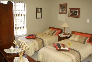 A bed or beds in a room at The Third Dolphin