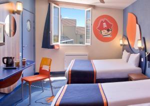 Un ou plusieurs lits dans un hébergement de l'établissement Explorers Hotel Marne-la-Vallée