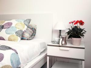 A bed or beds in a room at MI. Style
