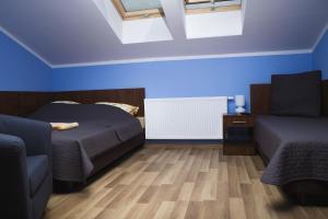 Posteľ alebo postele v izbe v ubytovaní Apartament Serwis