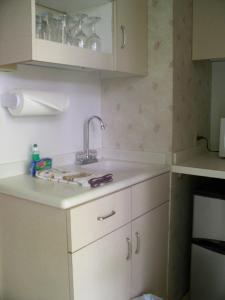 A kitchen or kitchenette at Kona Islander Inn Hotel