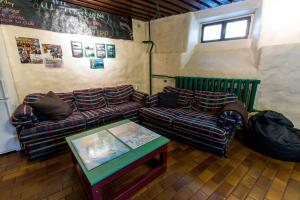 A seating area at Old Town Hostel Alur