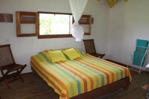 Ein Bett oder Betten in einem Zimmer der Unterkunft Residences Guadeloupe