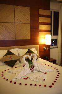 Giường trong phòng chung tại Vian Hotel