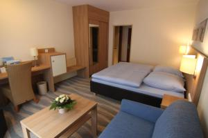 Ein Bett oder Betten in einem Zimmer der Unterkunft Inselhotel Bruns
