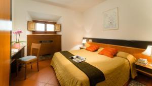 Cama o camas de una habitación en Residence San Niccolò