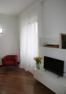 Télévision ou salle de divertissement dans l'établissement Residenza Pomponio