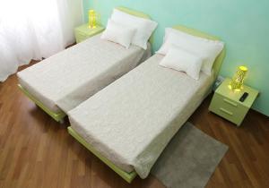 Un ou plusieurs lits dans un hébergement de l'établissement Residenza Pomponio