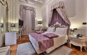 Een bed of bedden in een kamer bij Best Western Plus Hotel Genova