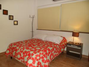 A bed or beds in a room at Apartment Alvarado