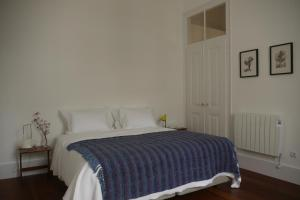 A bed or beds in a room at Casas Adentro