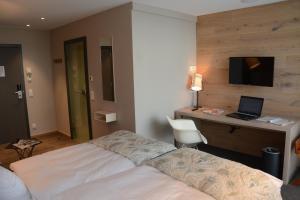 Ein Bett oder Betten in einem Zimmer der Unterkunft Bed&Bike Berliner Hof